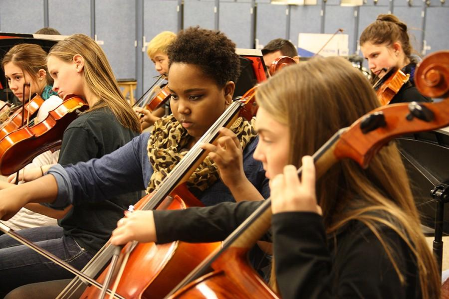 Orchestra members rehearsed before and after school prior to the Holiday Magic concert.