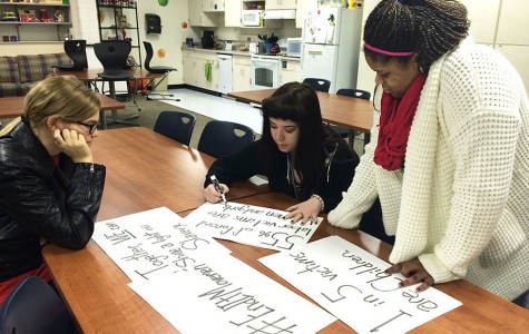 (Fom left to right) Kathleen Davids and Madeline Selby, sophomores, and Brazyl Donley, junior, work on signs for the SASH movement. Participants have decided to wear an X on their hands on Feb. 23-27 to raise awareness for the victims of human trafficking.