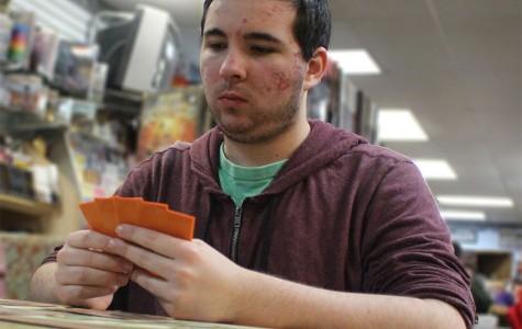 Josh Lane, senior, considers his cards during a game of Magic.