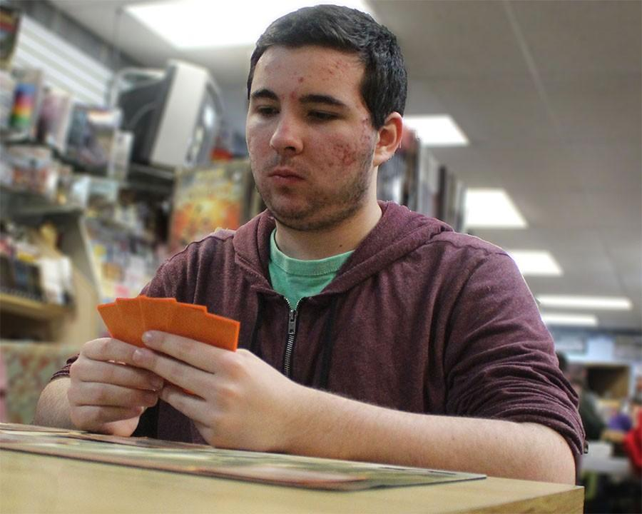 Josh Lane, senior, considers his cards during a game of Magic.