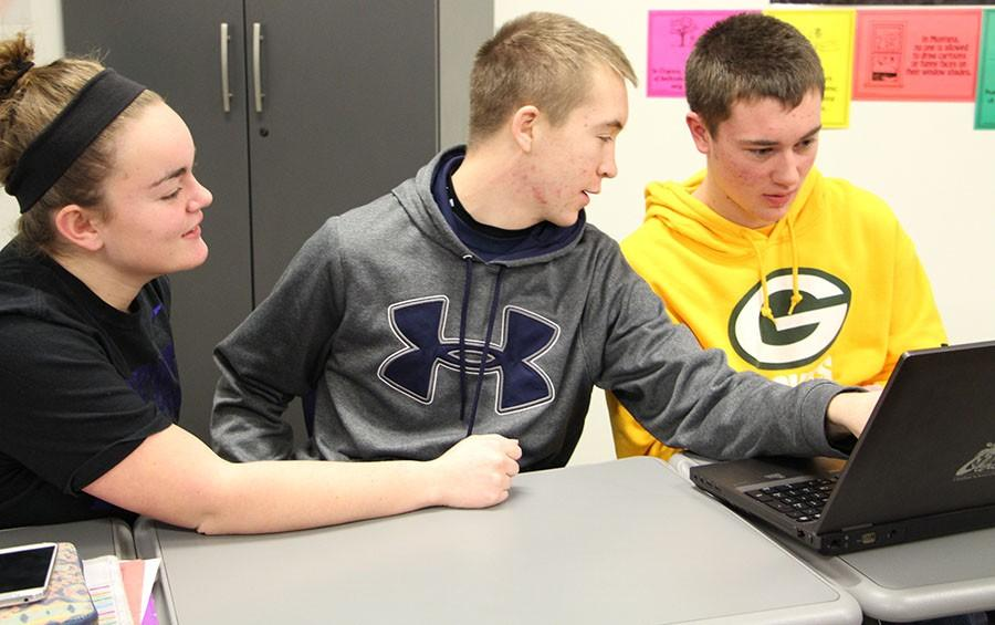 Mackenzie Baker, junior, Max Kepka, senior, and Troy Curfman, junior, are preparing for their upcoming Mock Trial court case. The students competed and managed to get fifth place. Amanda Doane, business teacher, sponsored the team during the competition and hopes the team will compete next year.