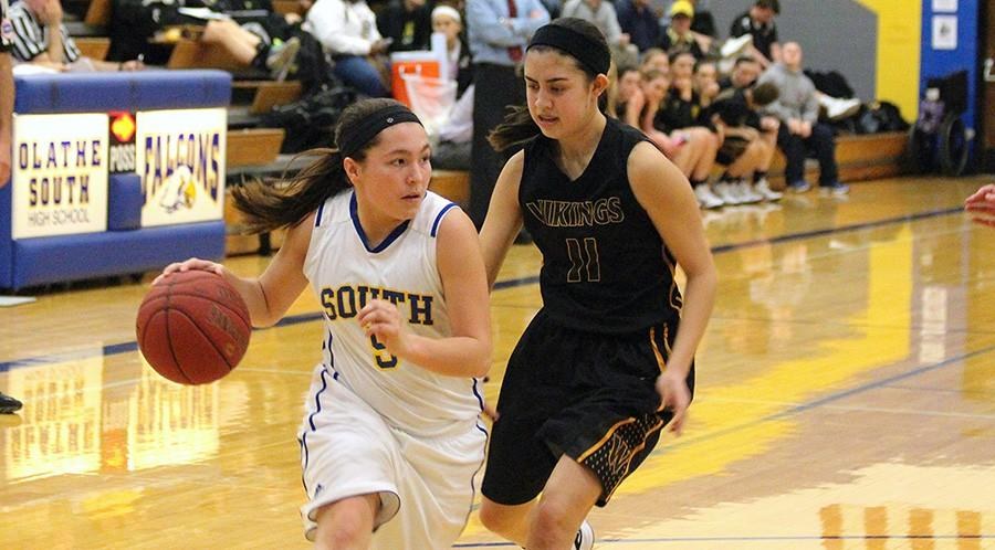 Michaela Gooch, sophomore, faces opponent head on while driving to the basket. The girls team competed at state.