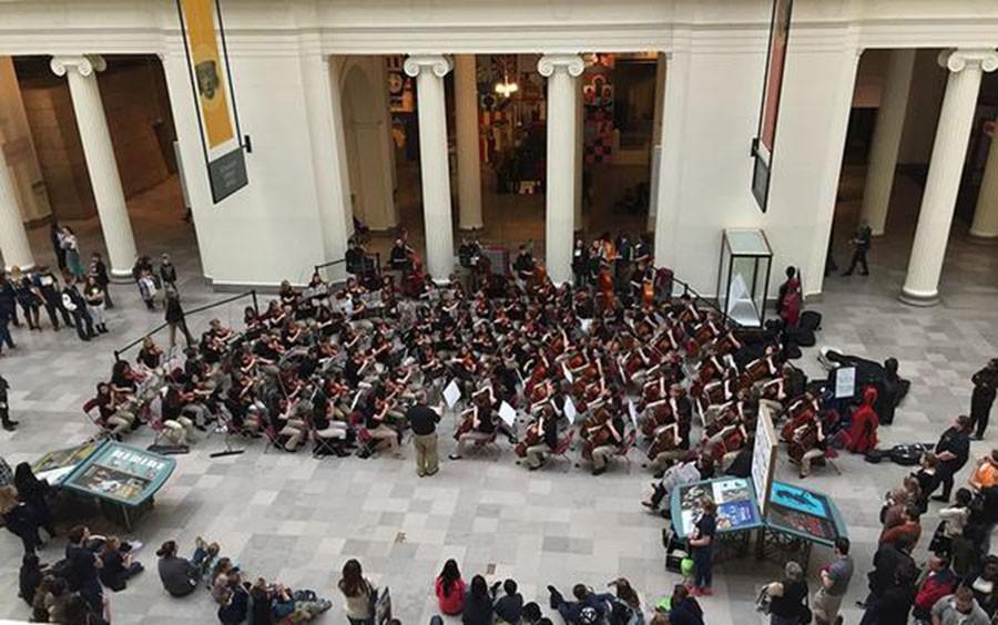Orchestra students performed at the Chicago Field Museum as part of their trip.