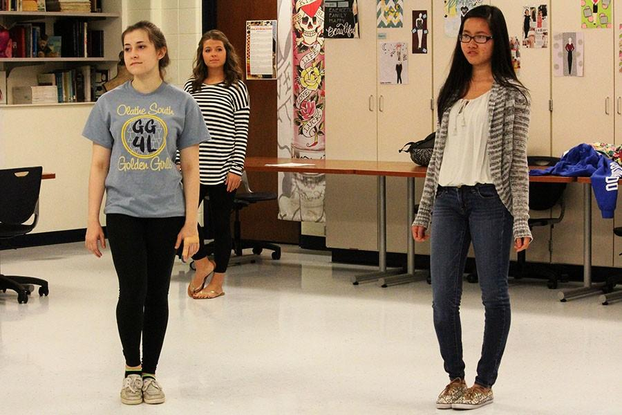Thuong Nguyen and Madison Reidy, seniors, and Sydney Shinkle, junior, practice their modeling