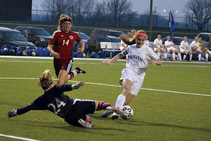 Brooke Prondzinski, senior, makes it past the goalie for the team's third goal.