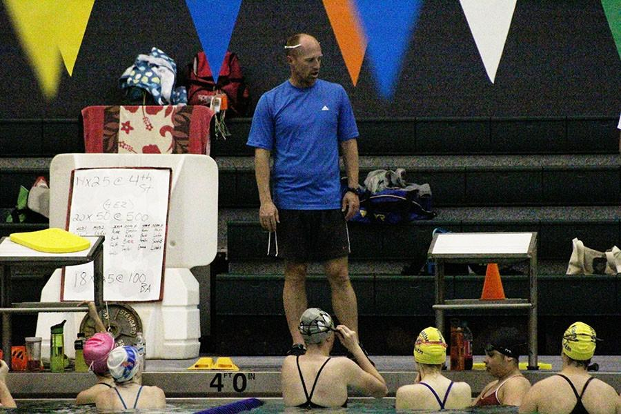 Brandon Simpson, head coach, instructs the girls swim team during a USRPT workout. Simpson believes that there are already  improvements being made early in the season.