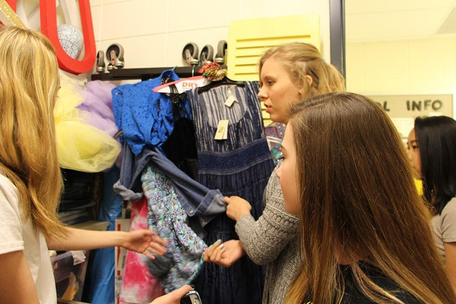 To plan the fashion show, the students consider what they have on hand as well as what they have in their own closets.