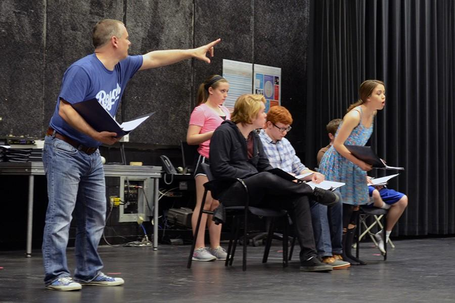 David Hastings, director, provides directions during rehearsal.