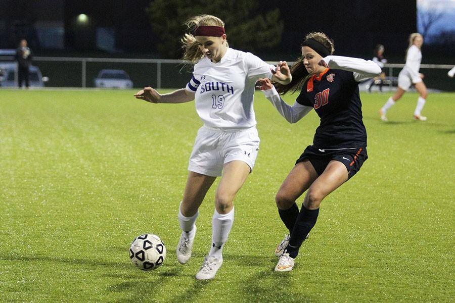 Brooke Prondzinski, senior, fighting for the ball.