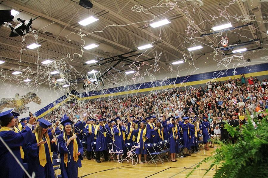 Students in the Senior Class spraying silly string following their graduation.