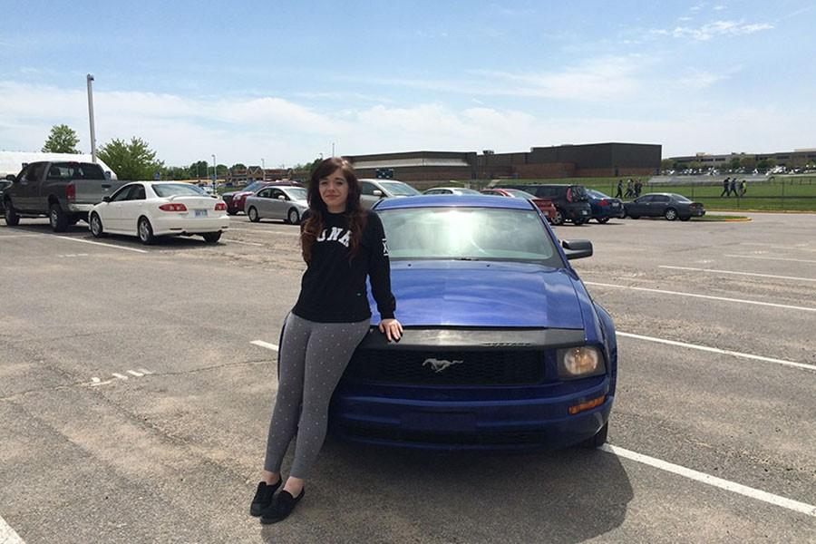 """Lexi Nelson,sophomore, 2005 Ford Mustang: Nelson's father bought the Mustang, paid it off, and passed it down to Nelson to drive. Besides the point that """"the car has really awful gas mileage,"""" as Nelson put it, she enjoys cruising around in the Mustang."""