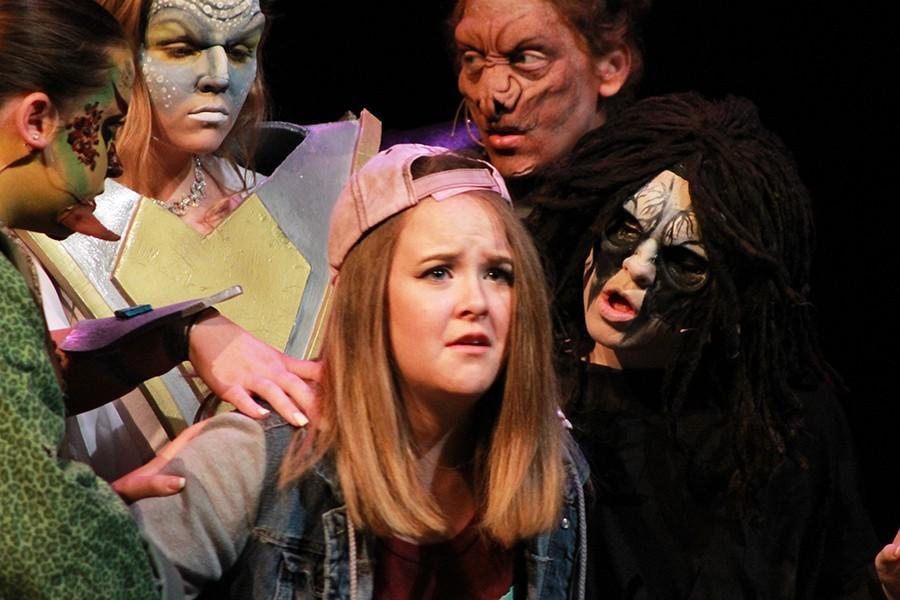 Ainsluy Wilbur, senior, is taken by aliens in the fall play.