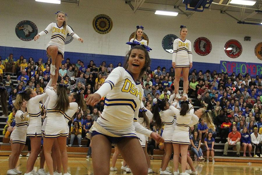 Grace Williams, junior, nae-naeing in the cheer routine at the homecoming assembly