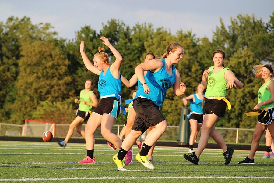 Junior and senior girls squared off in the annual Homecoming Powderpuff game.  The seniors took the honors and are celebrating their athleticism in the photo.
