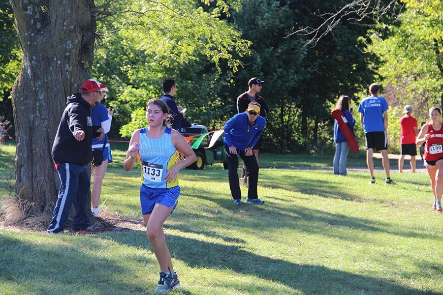 Emily Harrison (freshman) finishing the 5K at Lone Elm Park.