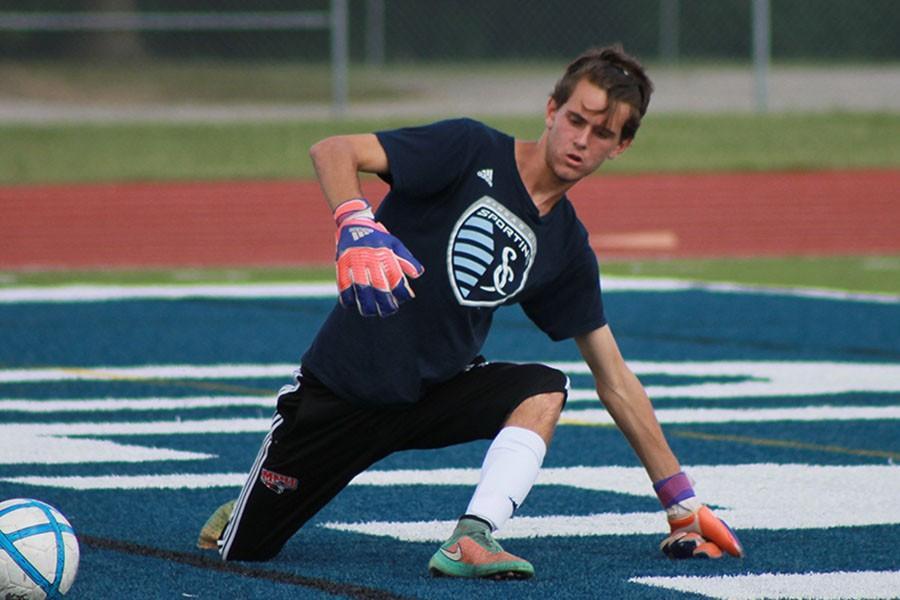 Max Carnes, senior, defends the goal during practice to prepare for a penalty shoot out.