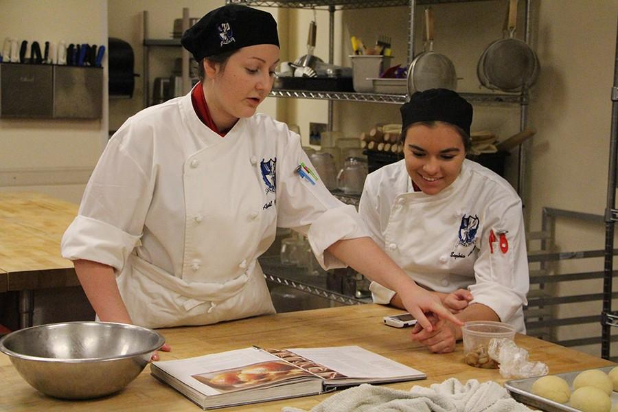 Culinary students, Abigail Cottingham and Sophia Hanson, juniors, separate and prep the ingredients that are necessary for their dish. They get the recipes from their instructor and learn the basic skills needed to prepare it. They not only spend time in the kitchen cooking, but they also learn the business and management skills needed to not only succeed in the culinary world, but also in the business world.