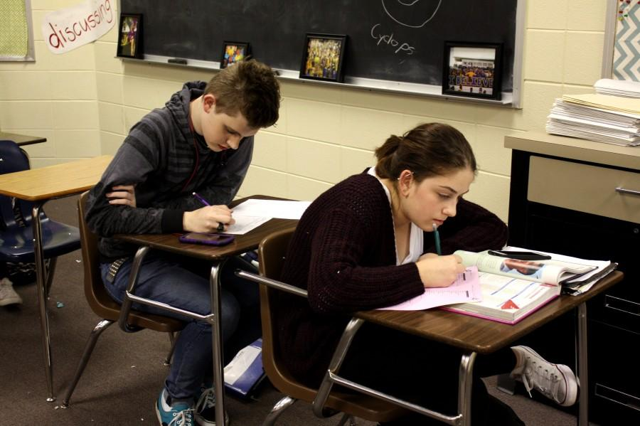 Students work on homework in the after school study hall offered.