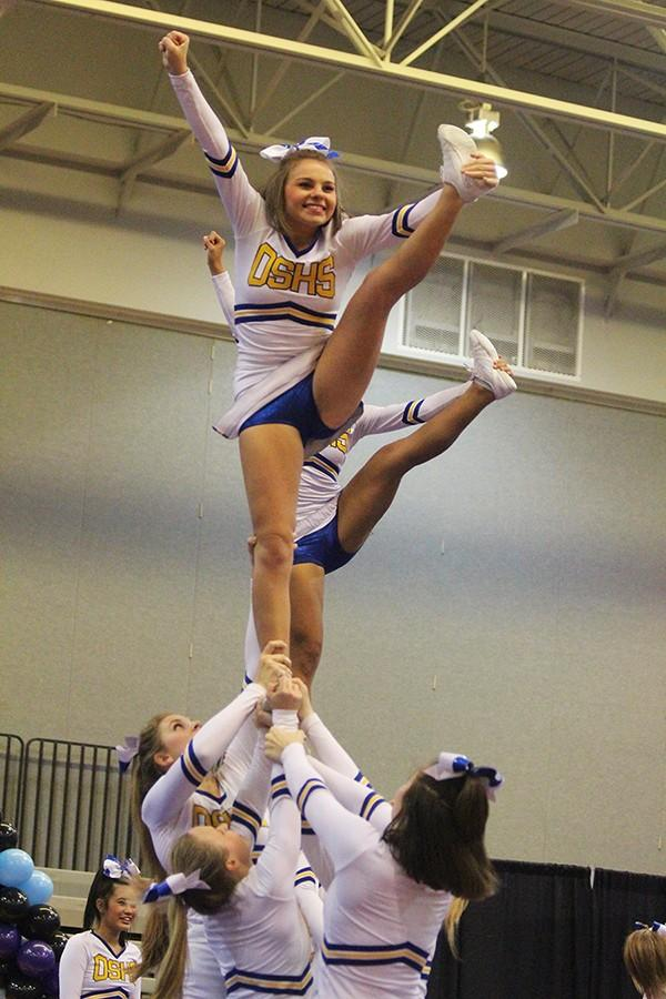 Emily Clapp, senior, flying at the Best of Midwest Cheer Competition.