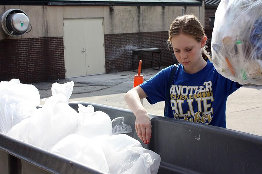 Myan Sanborn throwing away trash after school for Falcon Service Club