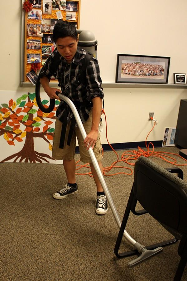 Johnson Poon Vacuuming for Falcon Service Club after school Oct. 21