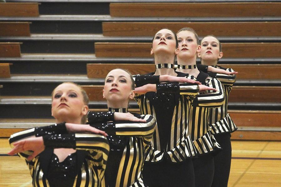 The Varsity Golden Girls performing their military routine.