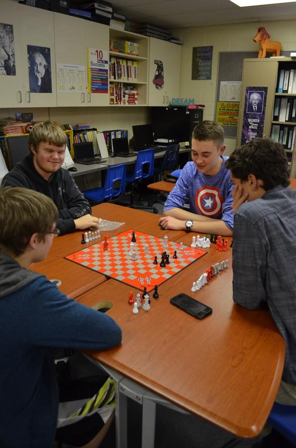Ryan Mersmann, Mitchell Liermann, and Troy Curfman, seniors; and Alex Pieri, freshman, play chess every other Tuesday in room 906. In addition to the four boys, there are about eight other members.