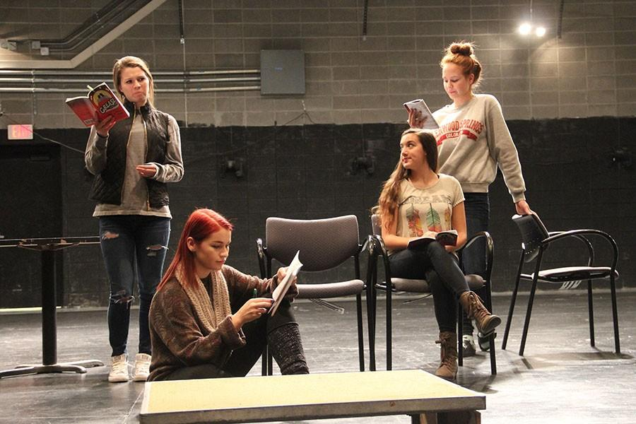 """Taylor Schoep, Annabeth Swanson, Andrea Strickler, seniors, and Kylee Wallentine, sophomore, rehearse their lines for the upcoming production of """"Grease."""" They have been working for the past few weeks to learn the show."""