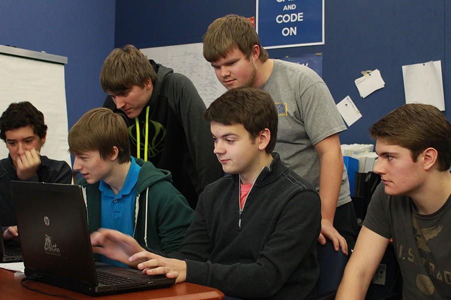 Ryan Mesrmann, Jeremy Morris, Andrew Fales, Mitchell Liermann, Nathaniel Helgeson, Kyle Robbinson, seniors, working on their senior project for CaSE.