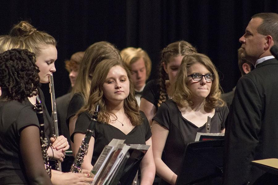 Sarah Miller and Courtney Williams, juniors, wait for instructions in between sets at the Winter Band concert.