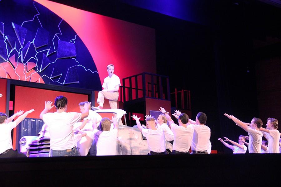 The male ensemble in Grease bowing to Caleb Nugent, senior, who played Kenickie.