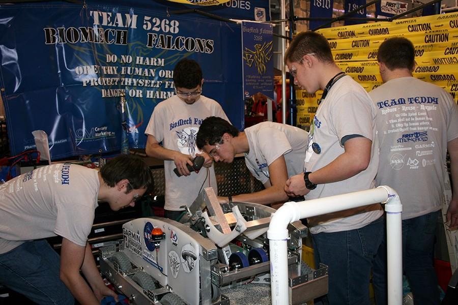 (Left to right)Ryan Mersmann, senior; Jaden Nuber, junior; Nathan Helgeson, senior; Brett Hale, junior; working on the robot.