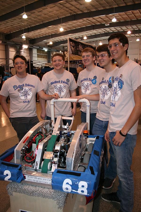 Sebastion Menez, Mitchell Slavik, Chris Sukstorf, Nathan Helgeson, Ryan  Mersmann, seniors, posing with their robot.