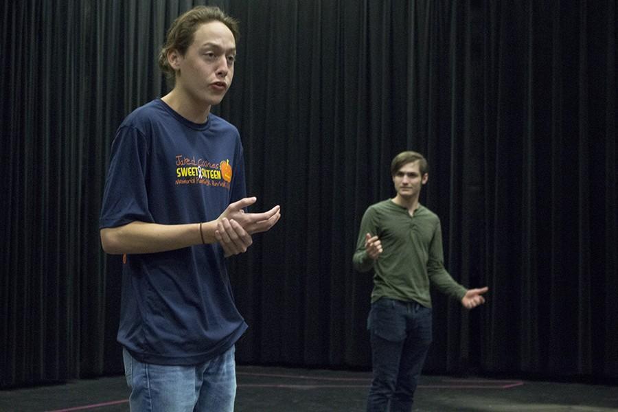 Matt Minelli, junior, and David Wernsman, senior, rehearse for the play.