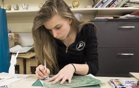 Mariah Case, senior, working on art.