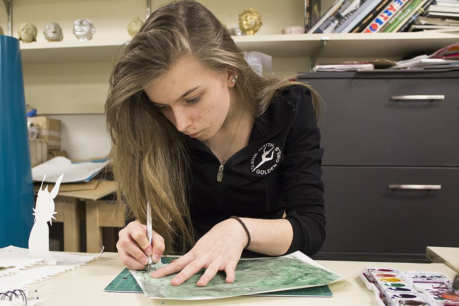 Mariah Case, senior, working on art.