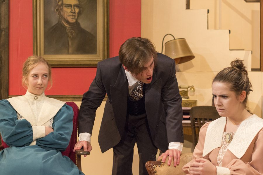 Deanna Bowls, David Wernsman, and Veronica Wood, seniors, act out an important scene in the play. The play had a running time of about two hours each performance.