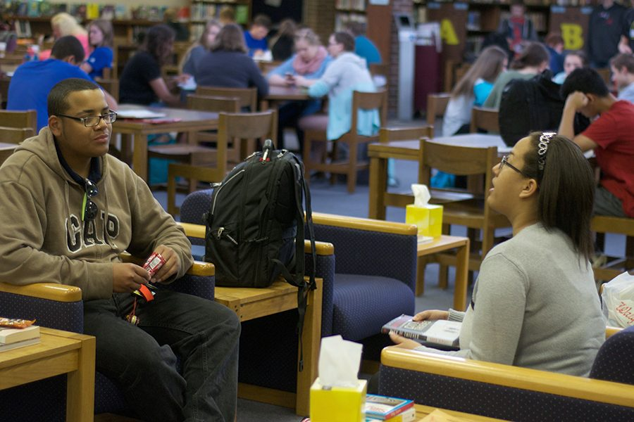 Dorian Coleman, sophomore, and Hannah Alleyne, junior, talk about books during a book club meeting.