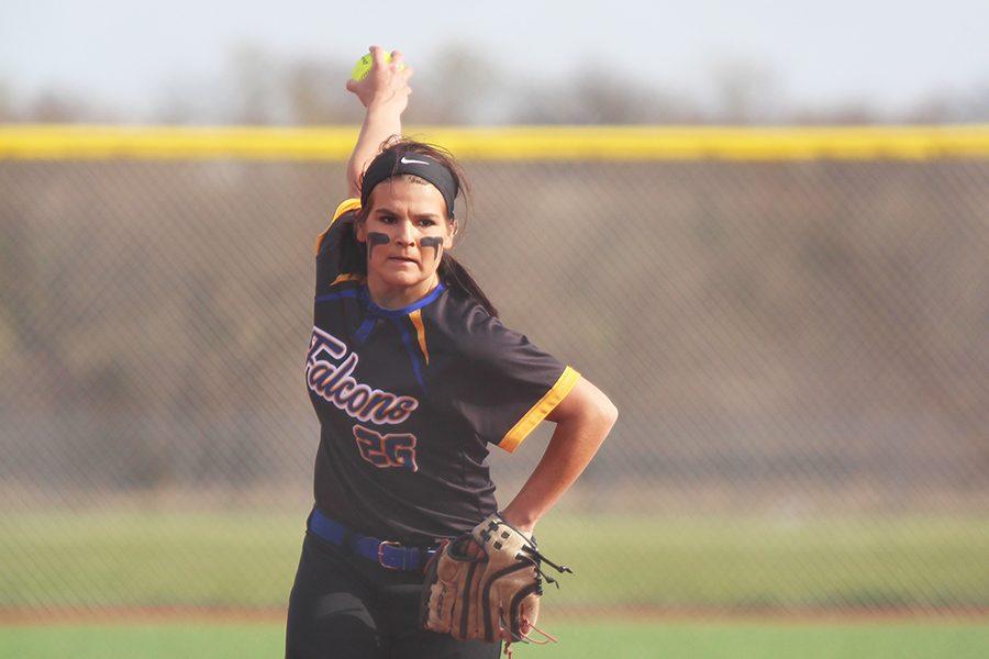 Lexie Storrer, senior, pitches.