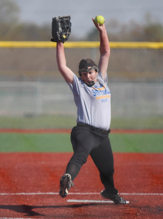 Lexie Storrer, senior, pitches during practice.