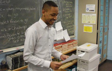 Courtland Triplett, senior, reading to the creative writing class