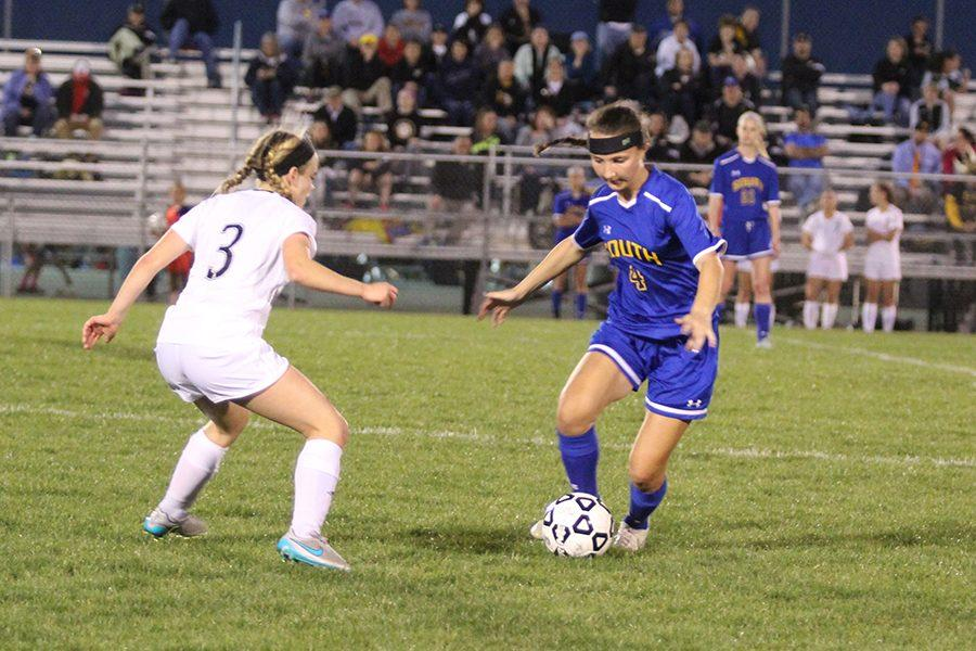 Ashlyn Richards, sophomore, dribbling up the field.