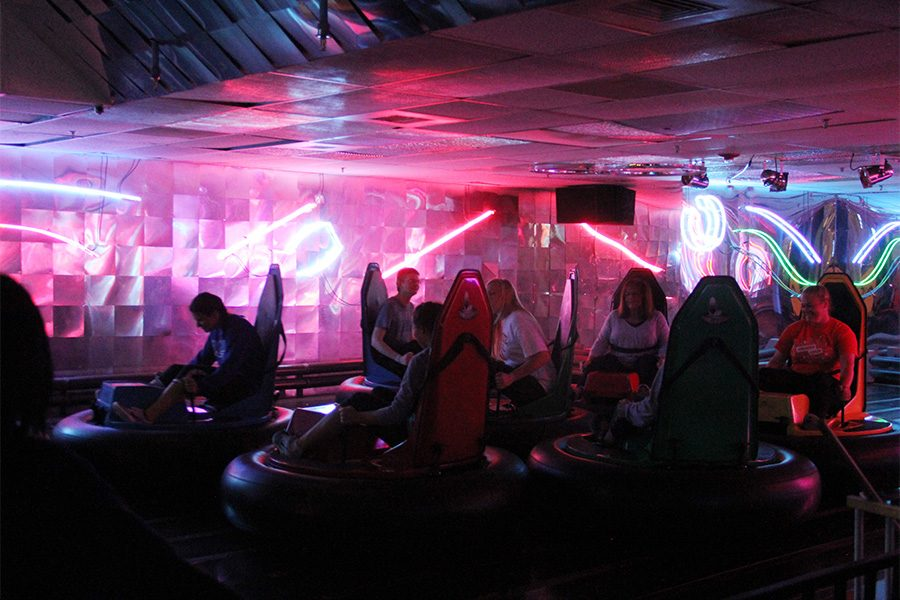 Seniors bump and spin each other while in their bumper cars. The students  enjoyed their time at PowerPlay where they played games, ate food and had a chance to relax before upcoming finals.