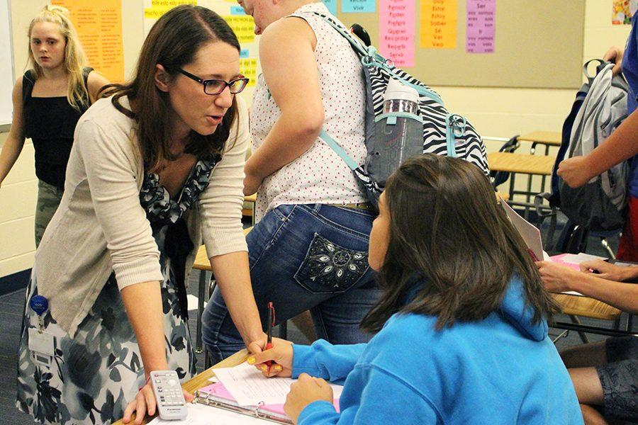 Lindsey Colling, Spanish teacher, is working with a student during class.