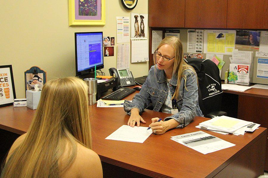 New counselor, Traci Johnston, helps a student.