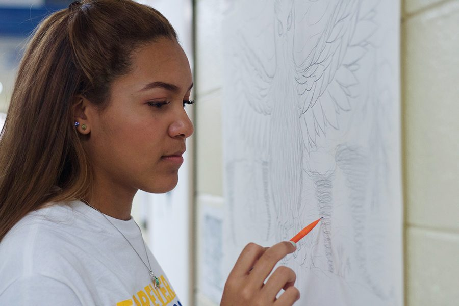 Brentleigh Greene, junior, works on a new drawing.
