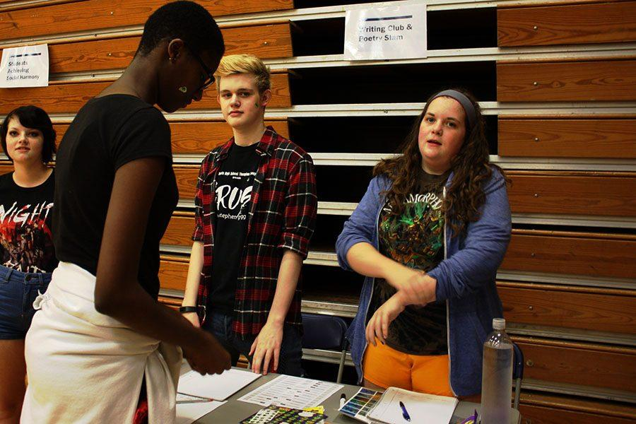 Thw Writing Club setting up their stand at the Activity Fair. 9/1/16 Cooper Dammrich, Kelly Sullivan, and Khadija C.