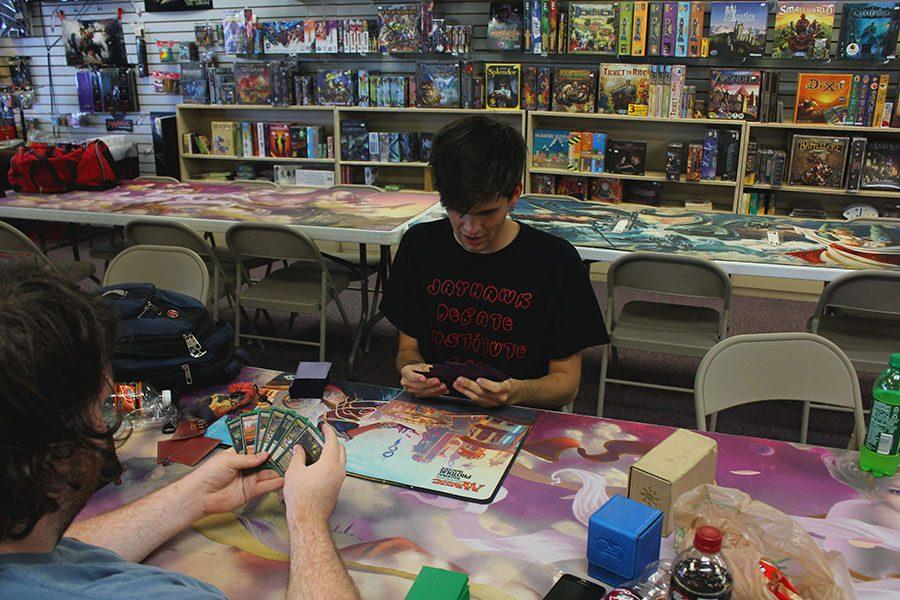 A variety of students, like Cameron Clark, senior, go to 31st Century every Friday for Magic: The Gathering tournaments.