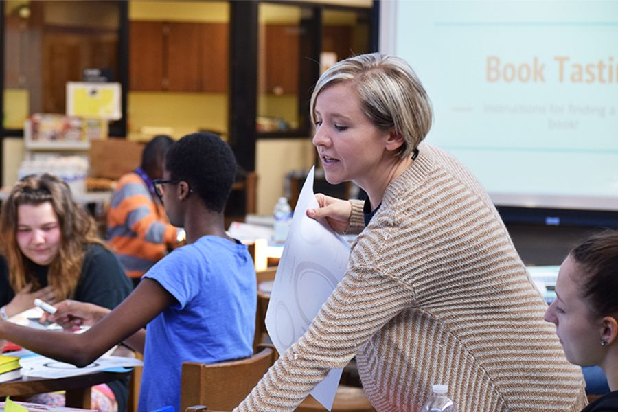 "Megan Roberts, librarian,collects the ""meal"" sheets to explain how the book tasting event works during the first half of seminar on Sept. 29."