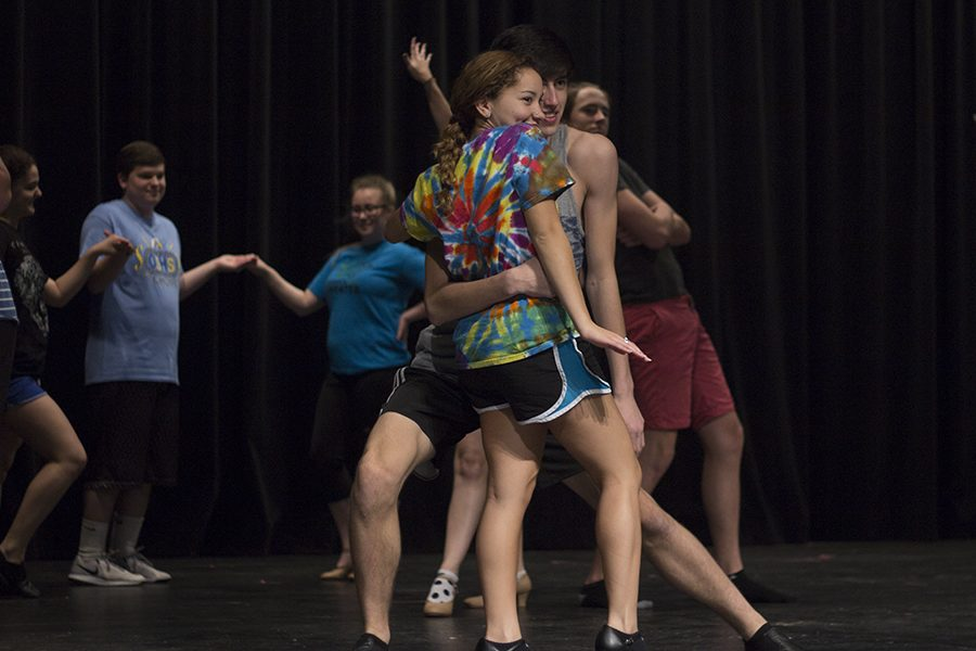 The cast of the fall play work on blocking and dancing.
